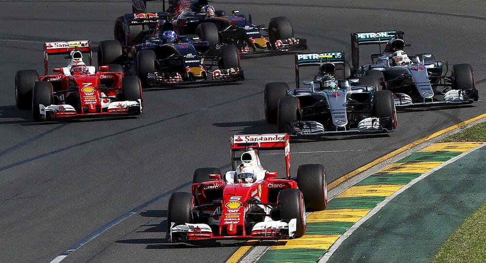 Ferrari F1 driver Sebastian Vettel leads the pack during the start of the Australian Formula One Grand Prix in Melbourne