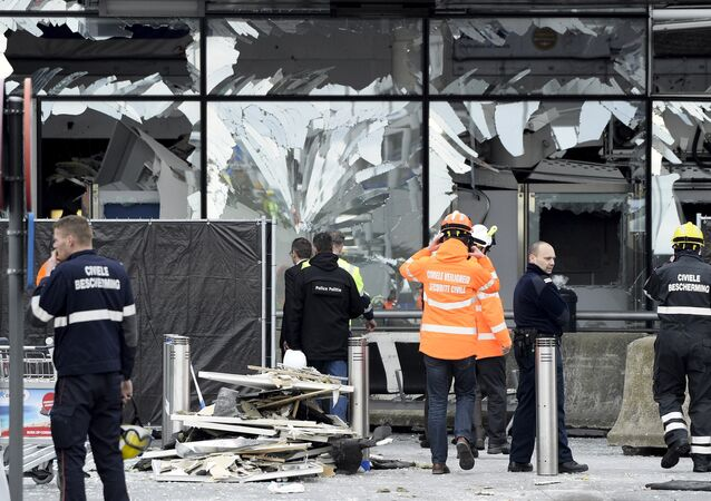 Broken windows of the terminal at Brussels national airport are seen during a ceremony following bomb attacks in Brussels metro and Belgium's National airport of Zaventem, Belgium, March 23, 2016