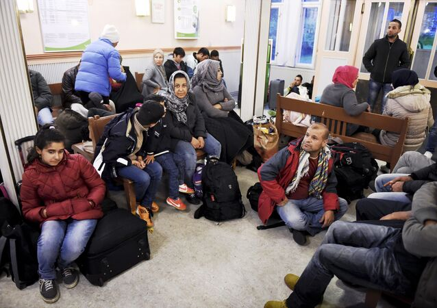 Iraqi refugees wait for a train to Helsinki at Kemi railway station in northwestern Finland, on 17 September 2015