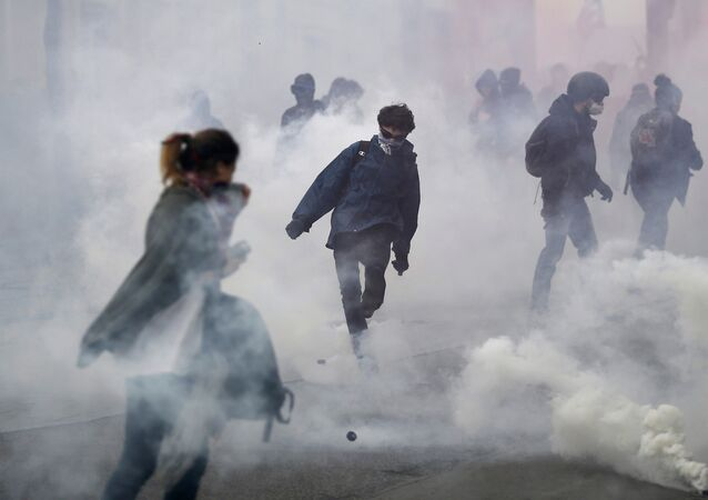 Cloud of tear gas surround French high school and university students take part in a demonstration against the labour reform bill proposal in Nantes, France, March 24, 2016 as part of a nationwide labor reform protest