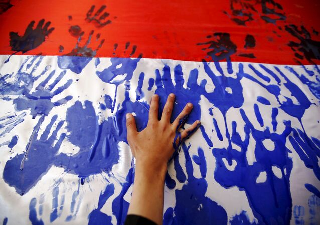 Hand prints on a Yemeni flag during a gathering held by Houthi loyalists against Saudi-led air strikes in Yemen's capital Sanaa March 9, 2016.