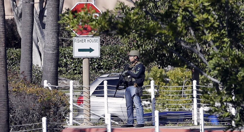 An armed officer is seen outside of the Naval Medical Center San Diego, Tuesday, Jan. 26, 2016, in San Diego