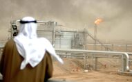 An employee of the Kuwait Oil Company (KOC) looks at 25 January 2005 the Gathering Center No.15 of al-Rawdatain field, 100 kms north of Kuwait City