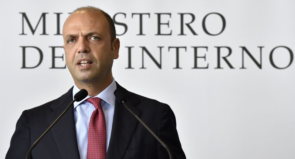 Italian Interior Minister Angelino Alfano speaks during a press conference after the departure of a group of Eritrean refugees from Italy to Sweden as part of a new programme of the European Union to relocate refugees on October 9, 2015 at the Ciampino airport of Rome