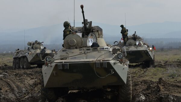 BTR-82A armored vehicles during the battalion tactical field firing exercise of the motorized infantry brigade of the Southern Military District at the Gvardeyets base in Shali district, Chechnya. - Sputnik International