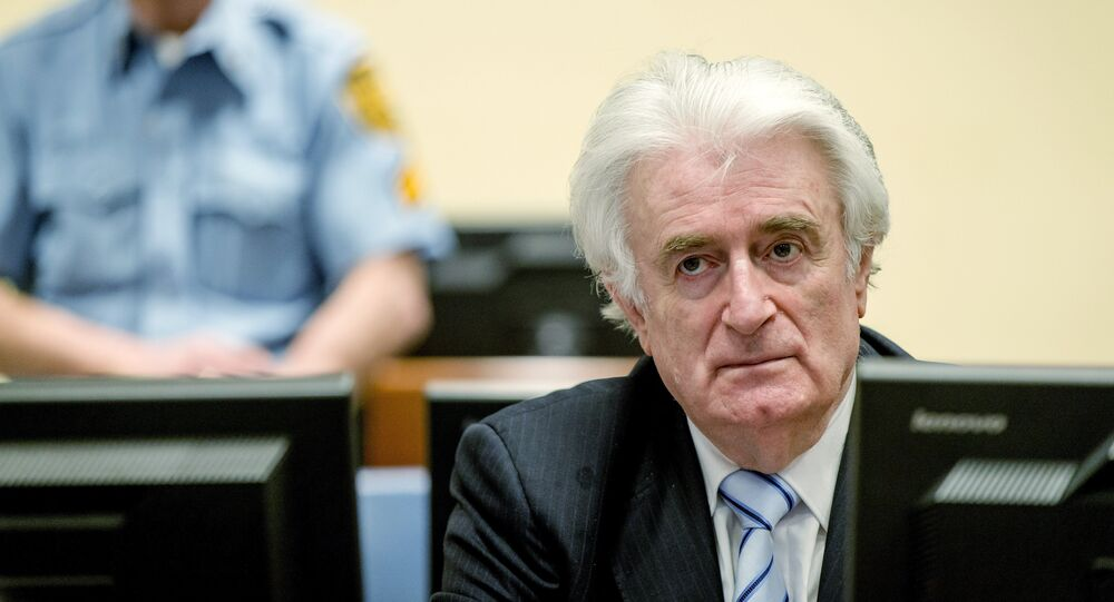 Bosnian Serb wartime leader Radovan Karadzic sits in the courtroom for the reading of his verdict at the International Criminal Tribunal for Former Yugoslavia (ICTY) in The Hague, on March 24, 2016.