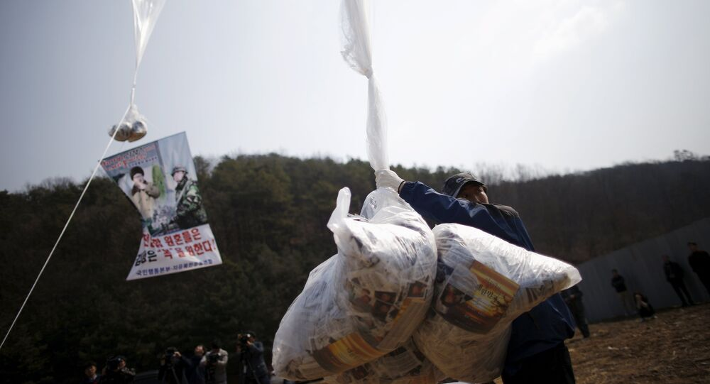 Park Sang-Hak, a North Korean defector living in the South and leader of an anti-North Korea civic group, holds a balloon containing leaflets denouncing North Korean leader Kim Jong Un, near the demilitarized zone separating the two Koreas in Paju, South Korea, March 26, 2016, on the sixth anniversary of the sinking of the naval ship Cheonan.