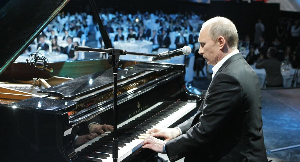 Russian President Vladimir Putin (then Prime Minister) plays the piano at a charity concert for children stricken with cancer and eye diseases held at St. Petersburg's Ice Palace, December 10, 2010.