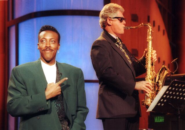 FILE - In this June 3, 1992 file photo, Arkansas Gov. Bill Clinton, plays the saxophone as host Arsenio Hall stands by during a campaign stop on The Arsenio Hall Show in Los Angeles. After two decades, Hall is returning to late night television with The Arsenio Hall Show, premiering on Sept. 9.