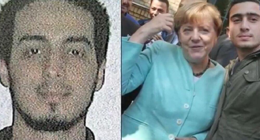 Merkel and refugee selfie