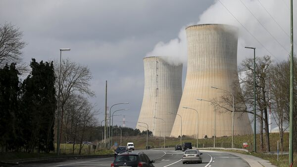 Steam escapes from the cooling tower of the Tihange nuclear power station, one of the two large-scale nuclear power plants in Belgium, March 26, 2016. - Sputnik International