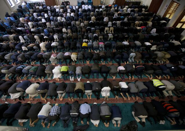 Men take part in prayers at the 7,000 worshipper capacity East London Mosque in east London, the largest mosque in the United Kingdom