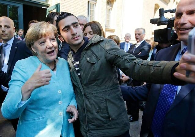 Anas Modamani with Angela Merkel