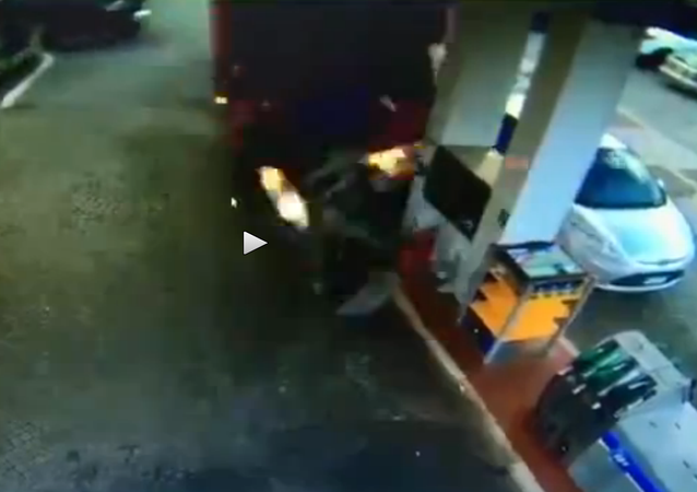 Lorry out of control crashes into gas station (two angles)