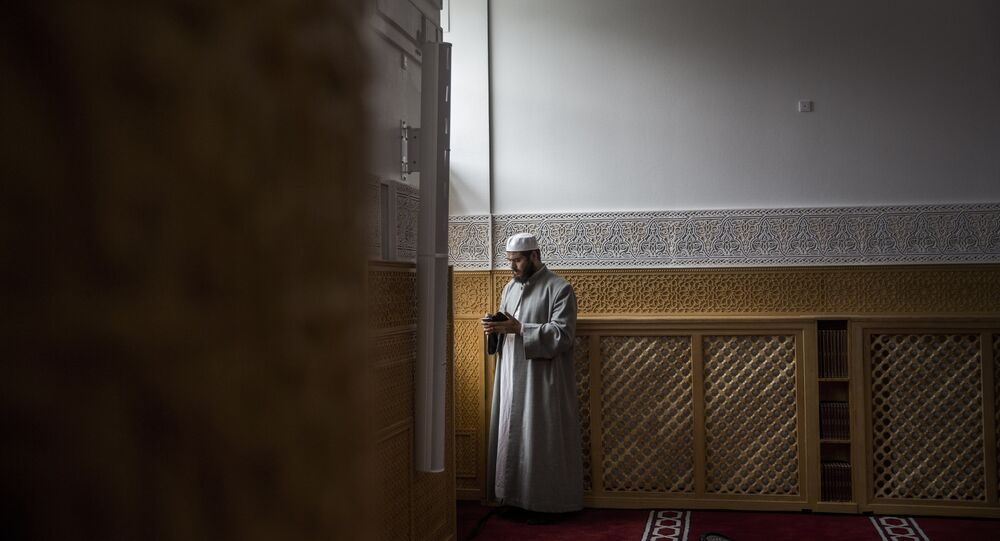 A man is pictured on 19 June 2014 during the official opening of Denmark's first mosque with a dome and minaret in Rovsingsgade, in Copenhagen's gritty northwest, after receiving a 150 million kroner (20.1 million euro, $27.2 million) endowment from Qatar.