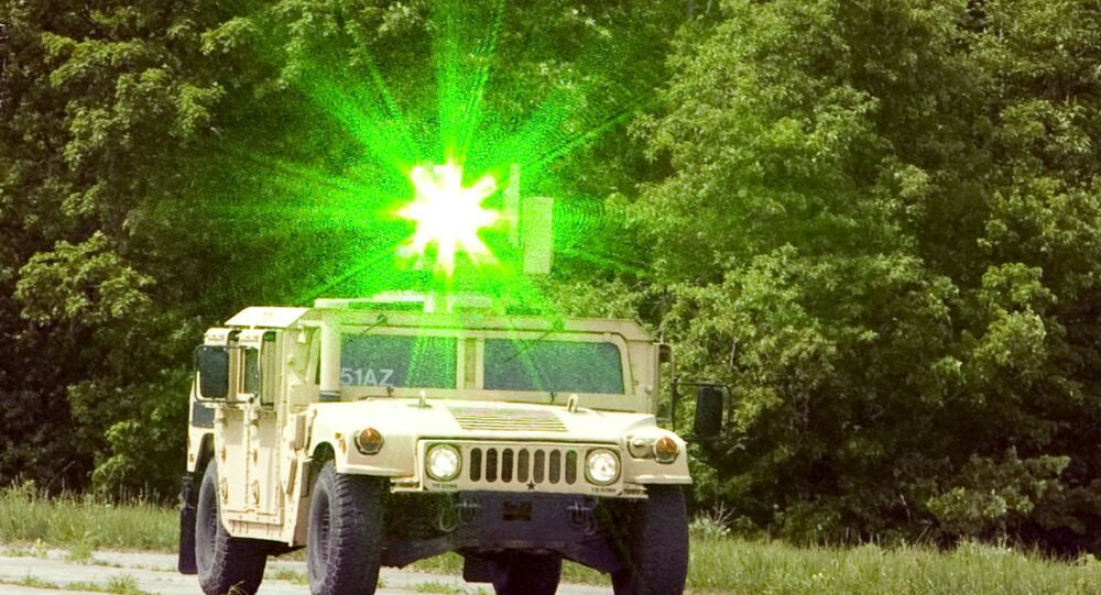 Laser system mounted to a military humvee.