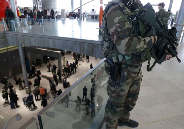 French soldiers patrol inside the Charles de Gaulle International Airport in Roissy, near Paris