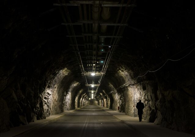 A Cheyenne Mountain Air Force Station employee walks to the mountain's complex almost a mile to get to the blast doors and into the facility