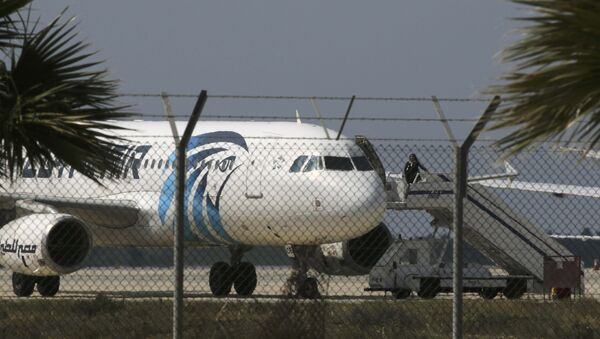 An official boards a hijacked Egyptair A320 Airbus at Larnaca Airport in Larnaca, Cyprus, March 29, 2016 - Sputnik International