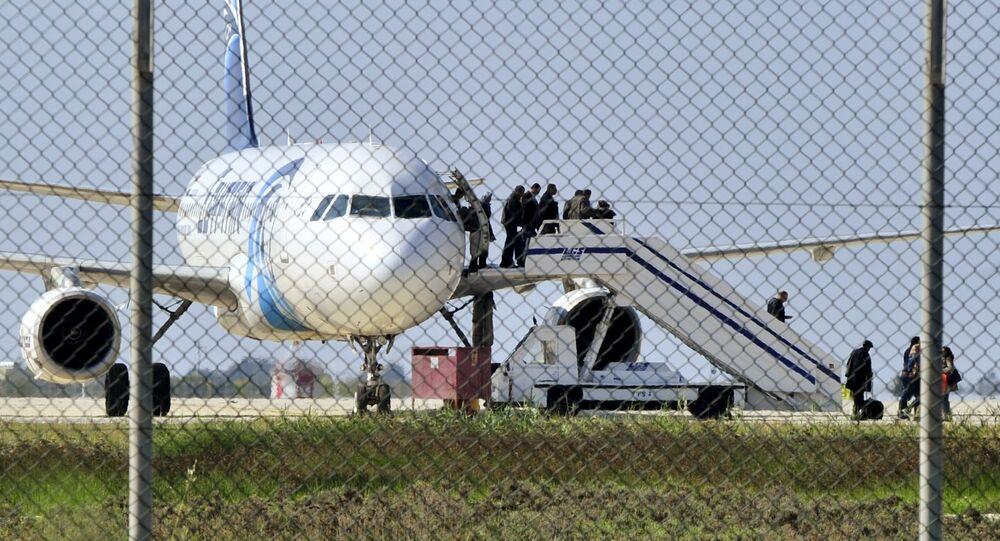 Passengers evacuate a hijacked EgyptAir Airbus 320 plane at Larnaca airport, Cyprus, March 29, 2016