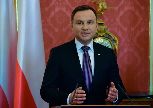 Polish President Andrzej Duda answers to a journalist's question in Maria Therese Hall of the presidential palace of Buda Castle in Budapest.
