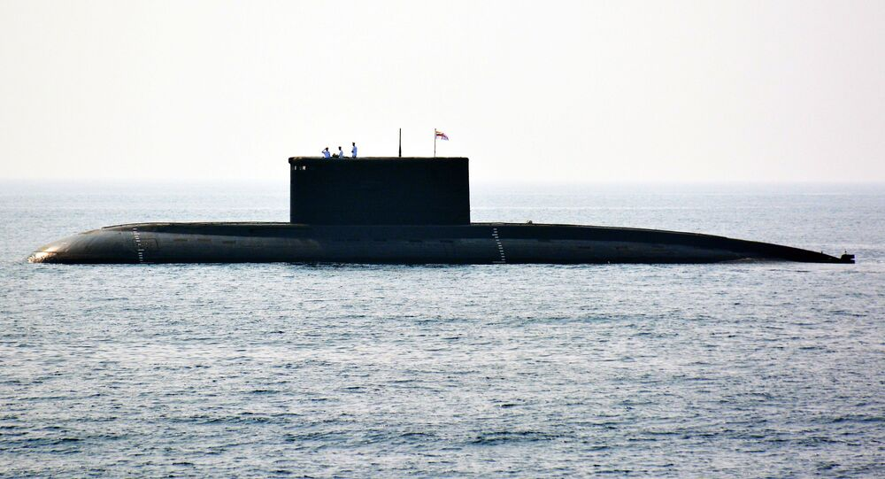 Indian Navy personnel stand on an Indian Navy submarine during the International Fleet Review in Visakhapatnam on February 6, 2016