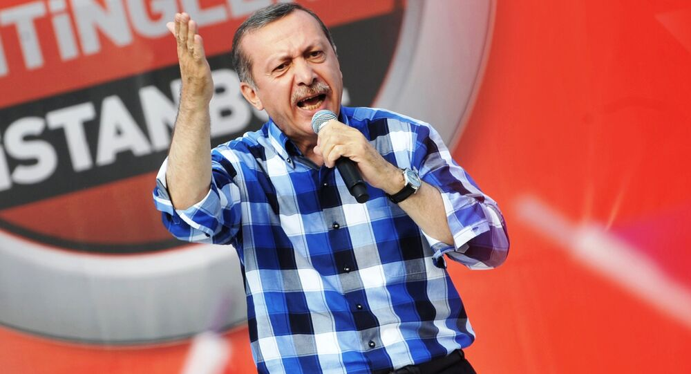 Turkish Prime Minister Recep Tayyip Erdogan makes a speech to supporters during a rally on June 16, 2013, in Istanbul.