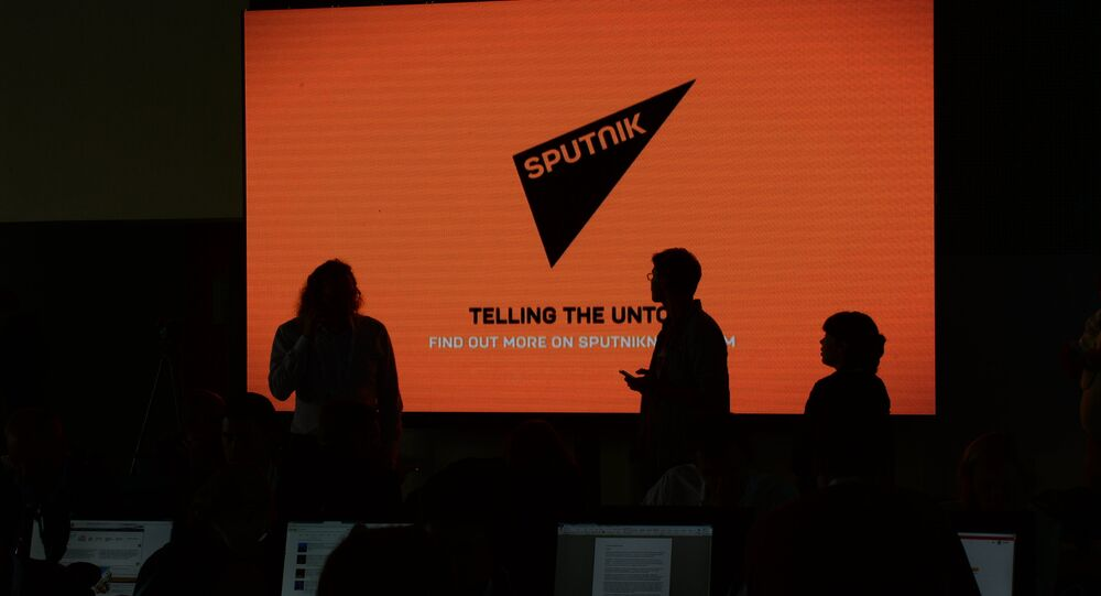 A screen with the logo of the Sputnik international news agency