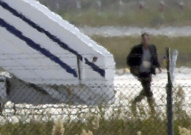 A man thought to be the hijacker leaves the hijacked Egyptair Airbus A320 at Larnaca Airport in Larnaca, Cyprus, March 29, 2016