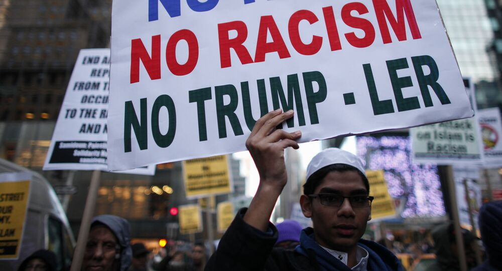 A Muslim youth holds a poster during a protest against Donald Trump on December 20, 2015 in New York