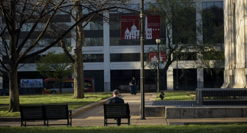 A man sits in Mt. Vernon Square near the Washington Convention Center where a nuclear summit will be held this week March 30, 2016 in Washington, DC