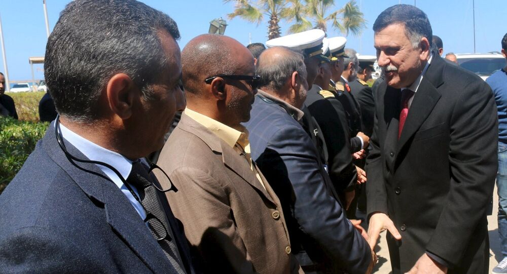 Libyan Prime Minister-designate Fayez Seraj (R) is greeted upon arrival in Tripoli, Libya March 30, 2016