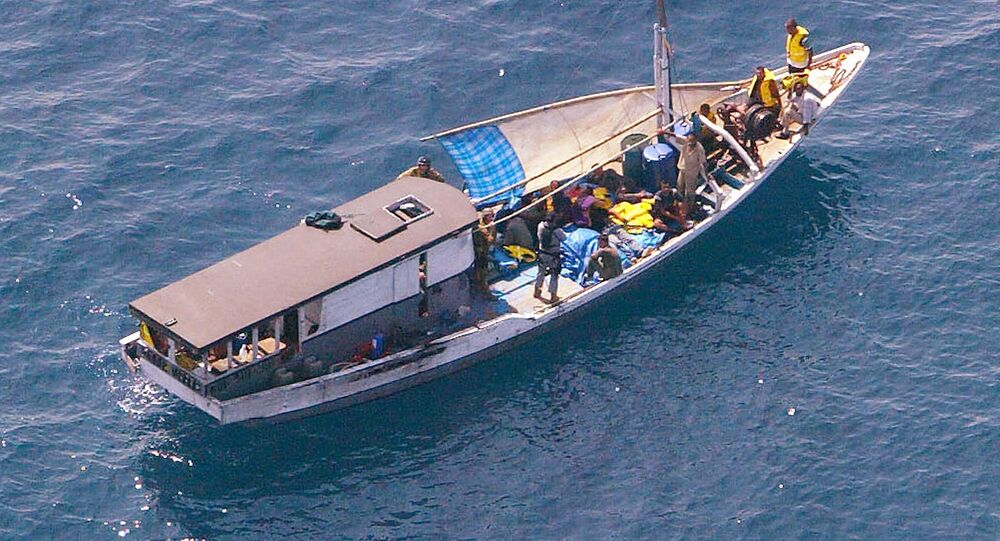 Turkish Kurd refugees on an Indonesian fishing boat are guarded by Navy personnel 20 kms off Melville Island, near the northern mainland city of Darwin. The fate of the refugees suspected to be seeking asylum in Australia was unknown after they sailed into a legal storm over the country's tough immigration laws (File)