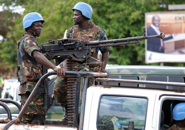 UN soldiers stand post with a machine gun on the back of a pick-up truck on October 23, 2014 in Beni