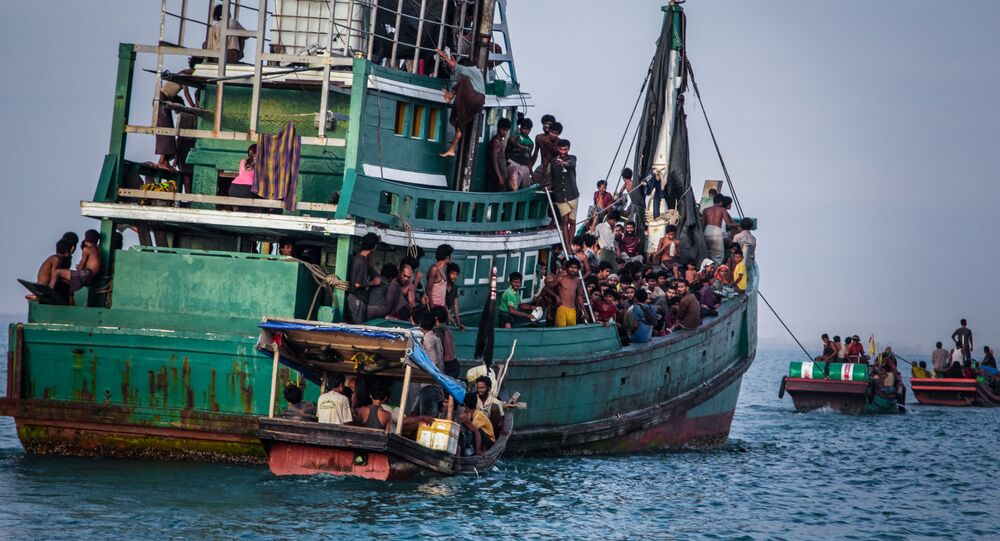 In this photo taken on May 20, 2015 shows Rohingya migrants resting on a boat off the coast near Kuala Simpang Tiga in Indonesia's East Aceh district of Aceh province before being rescued. Indonesia's foreign minister demanded answers from Canberra about claims Australian officials paid thousands of dollars to turn a boat back to Indonesia after Prime Minister Tony Abbott refused to deny the allegations