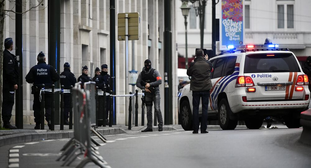Police block the street outside the council chamber in Brussels, where two terrorism cases will behind closed doors, on March 31, 2016
