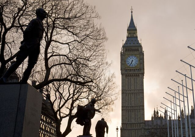 The sun rises behind The Elizabeth Tower, also known as 'Big Ben.'