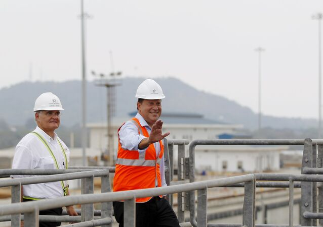 Panama's president Juan Carlos Varela gestures during his visit to the new set of locks at the Panama Canal Expansion project on the pacific side in Panama City March 18, 2016
