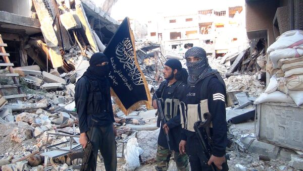 Fighters from the al-Qaida group in the Levant, Al-Nusra Front, stand among destroyed buildings near the front line with Syrian government solders in Yarmuk Palestinian refugee camp, south of Damascus on September 22, 2014 - Sputnik International