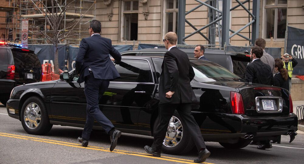 Security agents accompany the limousine of Turkish President Recep Tayyip Erdogan as he leaves the Brookings Institution where he spoke on the sidelines of the