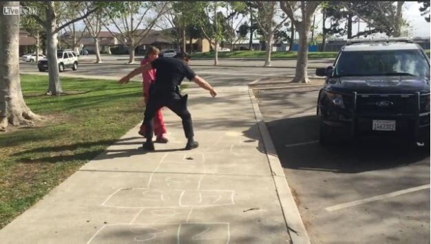 Cop Plays Hopscotch With Homeless Girl