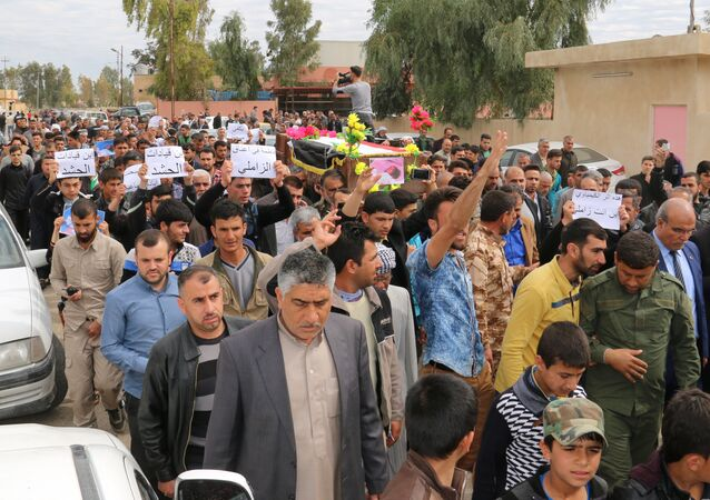 Iraqi men carry the coffin of three-year-old Fatima Wais, who was killed following a chemical attack by Daesh against the town of Taza, south of Kirkuk, during her funeral on March 11, 2016.
