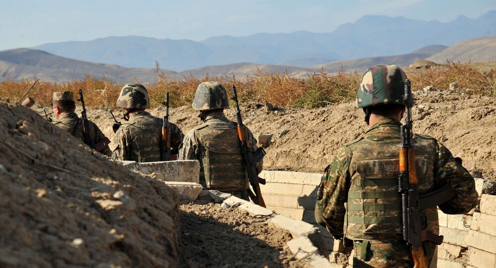 Armenian soldiers of the self-proclaimed republic of Nagorno-Karabagh walk in trenches at the frontline on the border with Azerbaijan, on October 25, 2012.