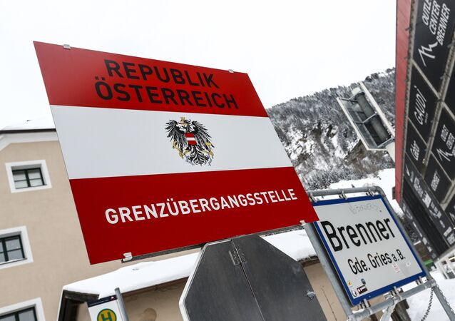 A border sign reading 'Republic of Austria - boarder' is seen in the Italian village of Brenner on the Italian - Austrian boarder.