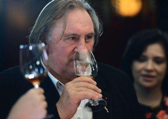 Actor Gerard Depardieu tastes Crimean wines in a Moscow restaurant.