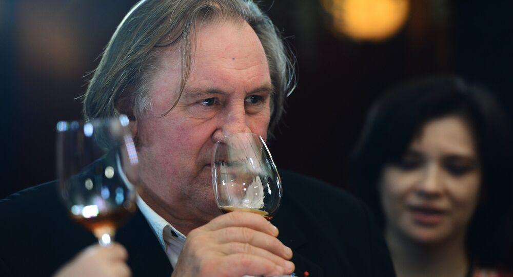 Actor Gerard Depardieu tastes Crimean wines in a Moscow restaurant.