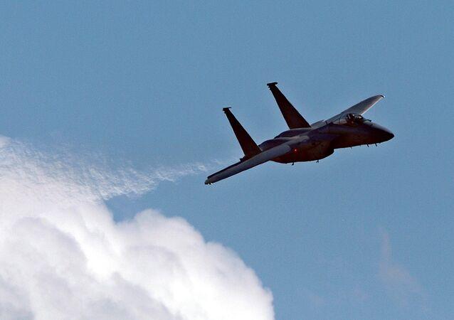 A US Air Force F15 streaks through the sky