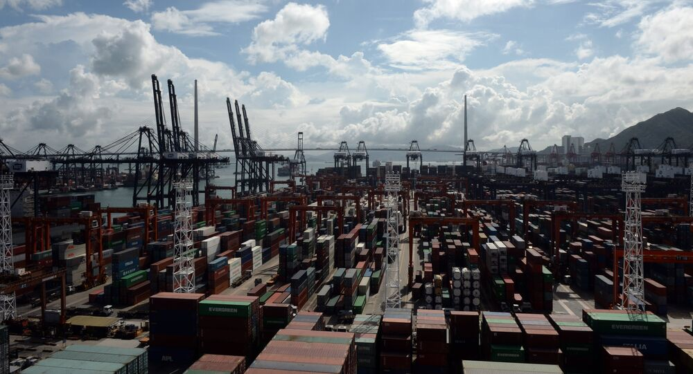 Containers and cranes are seen at a port in Hong Kong