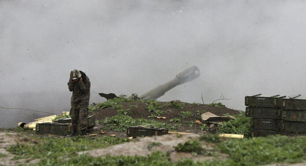 An Armenian serviceman of the self-defense army of Nagorno-Karabakh launch artillery toward Azeri forces in the town of Martakert in Nagorno-Karabakh region