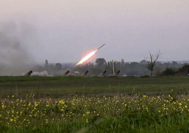 In this image made from video on Sunday, April  3, 2016, a Grad missile is fired by Azerbaijani forces in the village of Gapanli, Azerbaijan.